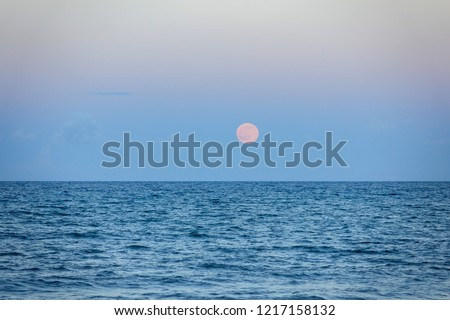 Full Rising Moon Over Ocean