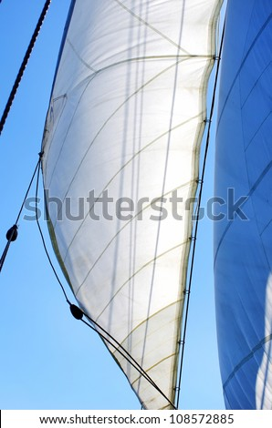 Full Sails on wind and blue sky