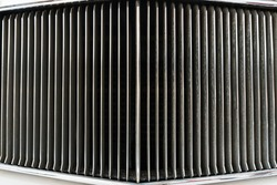 Full screen chrome grille of a vintage retro car. Detail of the front headlight