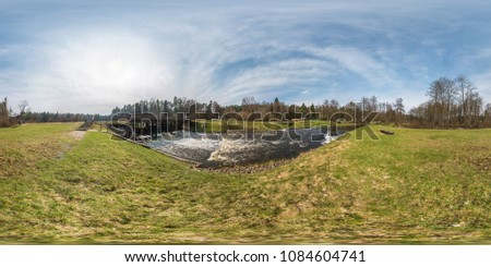 full seamless panorama 360 angle view dam lock sluice on the lake impetuous waterfall in sunny day. Skybox as background in equirectangular spherical equidistant projection for VR AR content #1084604741
