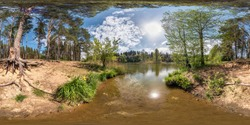 full seamless spherical panorama 360 degrees angle view on shore of lake in pinery forest with beautiful clouds with sun reflection in equirectangular projection