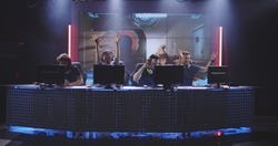 Full shot of a team winning a match at a gaming tournament
