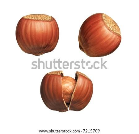 Full-size composite photo: closeup of whole and cracked hazelnuts. Isolated on white background.