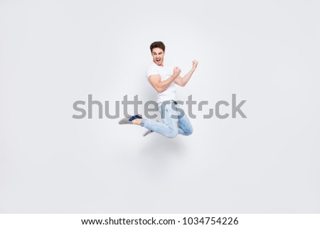 Full-size full-length portrait of attractive well-dressed nice-looking brutal macho manly fan enthusiastic strong guy raising fists up isolated on gray background