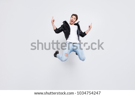 Full-size full-length portrait Yes yeah hooray! Careless funky funny excited cheerful joyful emotional guy clothed in trendy modern spring outfit demonstrating horns symbol isolated on gray background