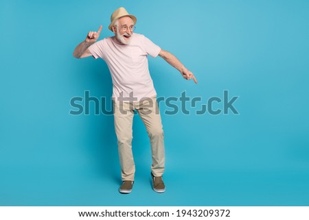 Full size photo of aged man pensioner happy positive smile have fun dance party isolated over blue color background Stockfoto ©