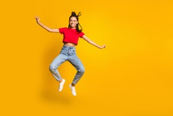 Full size photo of attractive carefree dark skin person jumping beaming smile isolated on yellow color background