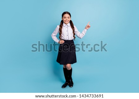 Full size photo of charming child have choice decision adverts isolated over blue background