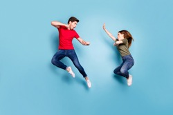 Full size photo of crazy mad two people married man woman jump train kickboxing exercise kick decide who is best wear green red t-shirt denim jeans isolaed over blue color background