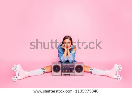Full-size photo of excited beautiful lovely girl sitting on twine in rollers with a boombox isolated on pink vivid background