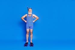 Full size photo of optimistic grey beard man wear fins mask blue swimsuit isolated on blue background