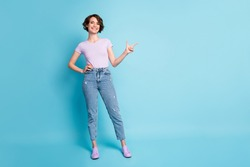 Full size photo of positive girl promoter point index finger copyspace indicate adverts promotion wear good look lilac outfit isolated over blue color background