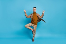 Full size photo of young funky funny smiling positive man doing yoga showing okay sign isolated on blue color background