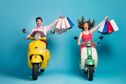 Full size photo positive two people man woman driver rider biker ride scooter motor bike shopping center buy bags enjoy off-sales wear red dotted dress shirt isolated blue color background