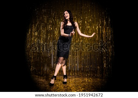 Full size portrait of gorgeous cheerful person dancing have good mood toothy smile isolated on stage light Foto stock ©
