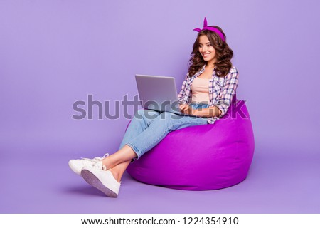 Full size portrait of style stylish trendy lady in casual checkered with her brunette wave curly hair she sit isolated on bright violet background enjoy work on pc gadget