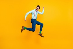 Full size profile photo of cool stylish guy jumping high up rejoicing winner wear specs shirt bow tie suspenders trousers shoes green socks isolated bright yellow color background