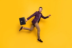 Full size profile photo of handsome stylish business guy jump high up rushing work office hold briefcase wear plaid shirt blazer trousers shoes isolated yellow color background