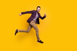 Full size profile photo of handsome stylish well-dressed business guy jump high up rushing store mall sales season wear plaid shirt blazer trousers shoes isolated yellow color background