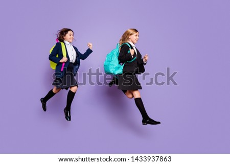 Full size profile side photo sweet kids run late elementary school wear skirt long socks stylish trendy isolated over purple violet background