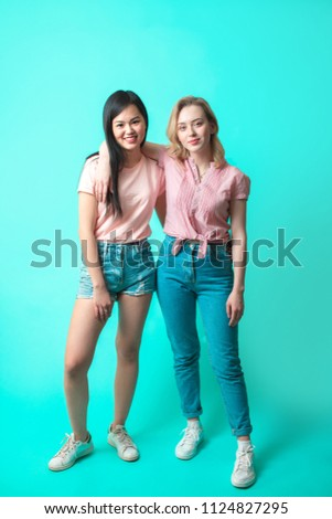 d48f53f4a0 Full-Size studio Portrait of a multiracial female couple casually dressed  in summer garment