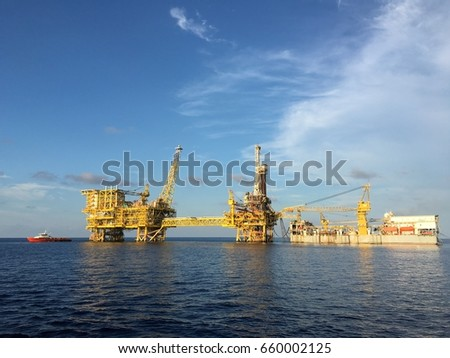 Full view of an offshore drilling platform at sea.