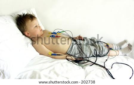 full view of boy getting ecg test