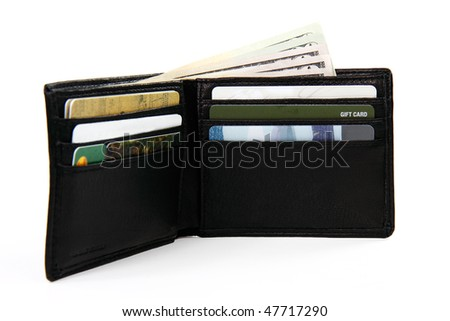 full wallet with money and gift cards; white background shallow focus