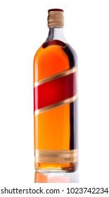 Stock Photo: Full whiskey bottle isolated on white background
