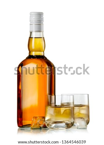 Full whiskey bottle and glasses with ice cubes #1364546039
