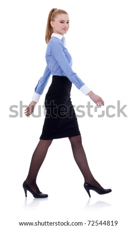 Fullbody business woman walking, isolated on white