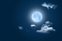 Fullmoon in night sky filtered blue tone with clouds for background