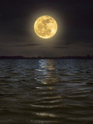 fullmoon reflected over the river