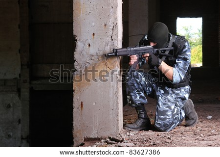Fully equipped military men with automatic weapons playing strikeball