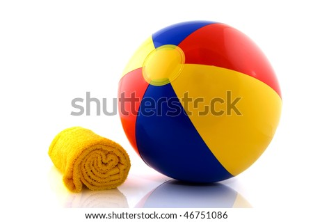 Fun at the beach with a colorful floated ball - stock photo