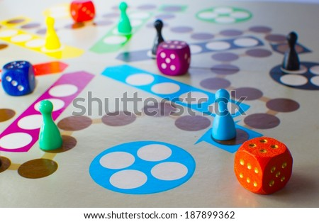 Fun board game with color pawns slot and dice for several people.