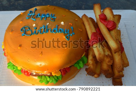 Fun Cake, Actual Happy Birthday Cake, Looks Like A Gigantic Hamburger with French Fries and Ketchup on the Side, Unusual, Top View, Great for Kids Concepts