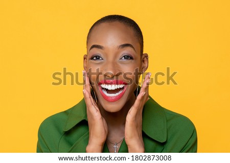 Fun close up portrait of Happy African American woman laughing with open palms in isolated studio yellow background Stock photo ©