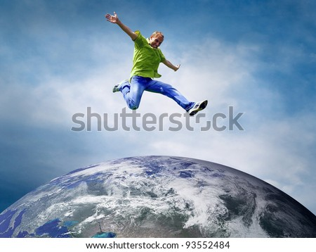 Fun couple in jump over the Planet Earth