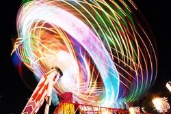 Fun Fair, long exposure. Colourful light trails.
