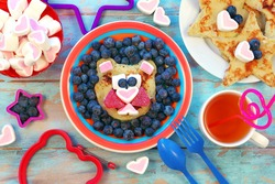 Fun food for children. Lion or bear shaped pancakes on blue wooden table. Healthy eating. Creative idea for kids breakfast.