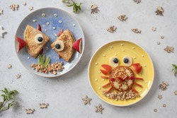 Fun Food for kids. Cute crab and lobster croissants with fruit for kids breakfast