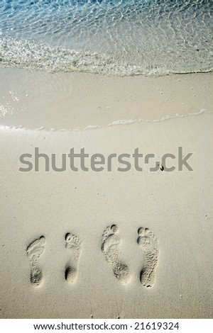 Fun footsteps on the coral sandy beach