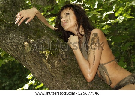 Fun girl posing with a loincloth on the nature