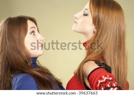 Fun humorous picture: one girl showing her domination and scaring another one girl.