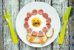 Fun idea for kids breakfast - fried egg with sausage and toast shaped cute lion
