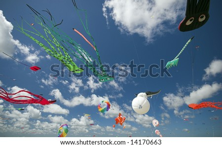 Fun in the Air. Fantasy Kites High-Up in the Blue Sky a Sunny Day on the Beach. Kite Flying Festival on Fanoe, Denmark.