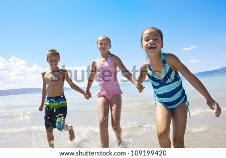 Fun Kids playing at the Beach