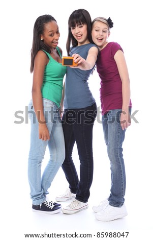 Fun photography with digital camera for three pretty young teenager girl friends a blonde caucasian, an oriental Japanese and an African American mixed race student all having a laugh together.