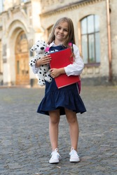 Fun playful haven. Happy child play with toy dog outdoors. Preschool education. Back to school supplies. Child development. Afterschool club. Creativity and imagination. Learning through play.
